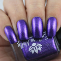 "Nail polish - ""Undeterred"" A vibrant purple metallic flake in a purple base."