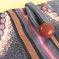 Purple blue white retro print iPad sleeve paired with brushed denim and