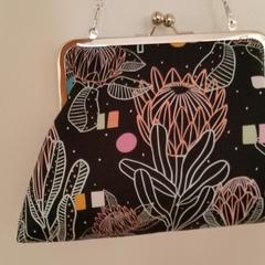 Black Proteas clutch bag with shoulder chain
