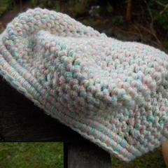 child's crochet beret made from bamboo. pastel yellow, pink and blue.