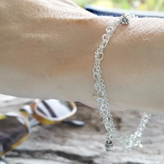 Dainty sterling silver multi-strand bracelet with small charms