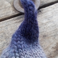 """child's knitted """"leaf"""" hat. newborn size made from wool and soy in blues."""