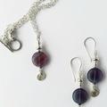 Long purple fluorite & silver dangle earrings with charms