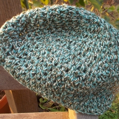 crocheted basic cloche made from pure wool yarns in blue, white and olive green