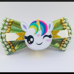 The Cute Winking Unicorn Hair Bow, comes as a beautiful hair tie