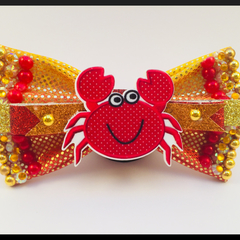 Cute Sand Crab Hair Bow comes as a beautiful hair tie.