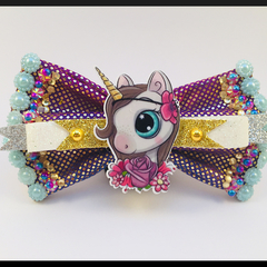 Darling Freckled Unicorn Hair Bow comes as a beautiful hair tie.
