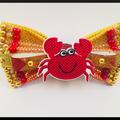 Cute Sand Crab Hair Bow comes as a beautiful hair tie.