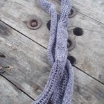 knitted scarf made from cotton blend yarn. Light and dark purple. Lace detail