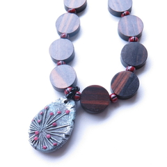 Organic beaded wood and polymer pendant necklace
