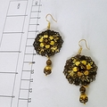 Two golds bold drop earrings.