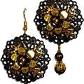 Two golds bold drop earrings.