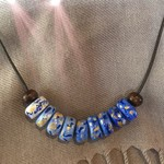 The blues handpainted clay and wooden beads