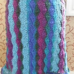 sidewaves crochet skirt. Pure wool and corn silk, blues and purples with green.