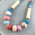 Handcrafted polymer clay adjustable necklace in turquoise pink on leather cord