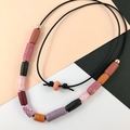Handcrafted polymer clay adjustable necklace in on leather cord