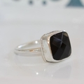 Square faceted cushion-cut black onyx and sterling silver ring.