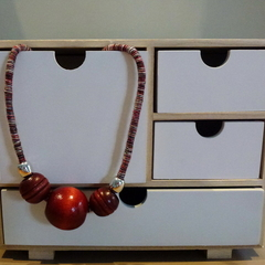 Wooden beads on red, white, grey woven cord