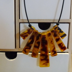 Recycled amber pendant on black cord