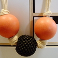 Coral and black wooden beads on cream cord