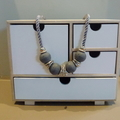 Recycled grey wooden beads, silver rings on grey cord