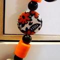 Orange, black and white beaded necklace