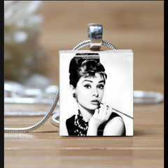 """Audrey Hepburn"", scrabble tile pendant. Comes with a pink braided necklace."