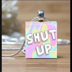 """SHUT UP"", scrabble tile pendant. Comes with a pink satin necklace."