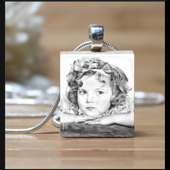 """Shirley Temple"", scrabble tile pendant. Comes with a purple leather  necklace."