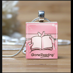 """Gone Reading"", scrabble pendant. Comes with a white leather braided necklace."