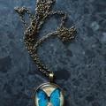 Glass butterfly pendant
