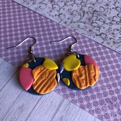 Shimmery orange and navy round drops, polymer clay earrings