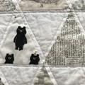 Modern handmade baby triangle quilt.