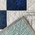 Modern handmade baby patchwork quilt.