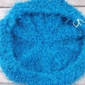 crocheted slouchy beret in teal acrylic. extra fluffy and warm. winter hat