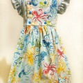 'Isobel' - size 4 pale blue with rainbow coloured octopus print fabric.