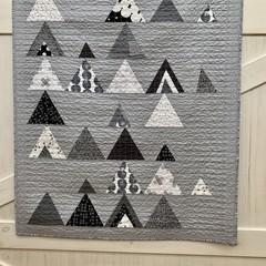 Modern handmade Mod Mountains quilt.