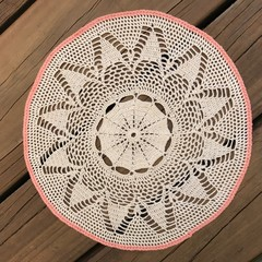 Round Table Mat edged in coral