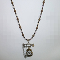 Bling bling. Old fashioned telephone pendant.