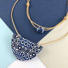 Handcrafted polymer clay adjustable pendant necklace in indigo blue