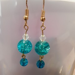 Turquoise pearl dangle earrings.