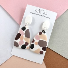 Polymer clay earrings, in white and nude pink spot
