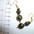 Casual, interesting, boho, metallic,long, antique, bronze earrings.