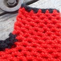 Crocheted fingerless mitts. Black and red and made from pure wool, size L.