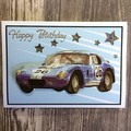 Birthday Card with Blue 3D Racing Car on Blue Background