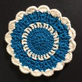 Two Turquoise and Chantilly Hand Crocheted Coaster on Pink Presentation Card