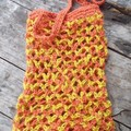 crocheted shopping carry string bag made from hemp yarn in orange and yellow