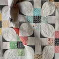 Modern handmade bed or couch throw patchwork quilt.
