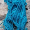 "knitted scarf ""snakes and ladders"" made from pure wool.  Lacy in rich mid blues."