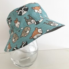 Boys summer hat in teal animal heads fabric
